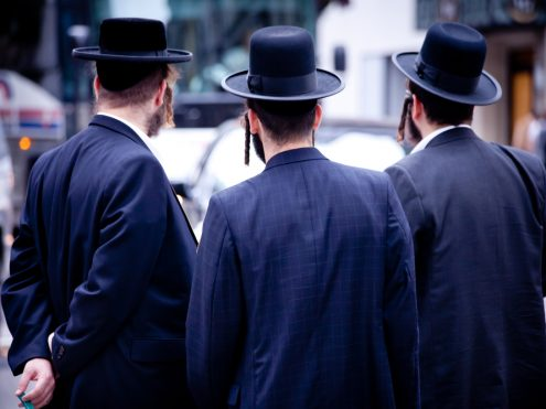 Jewish men with hat in a modern city